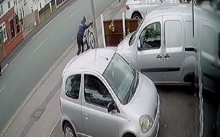 The man makes off with the bike