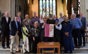 Holding up the faith covenant - signed by organisations across the city