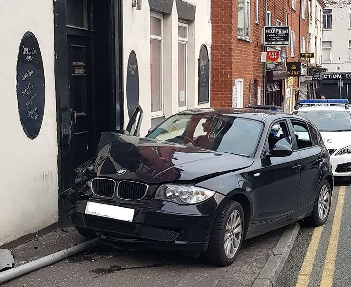 The damaged car in Grimshaw Street
