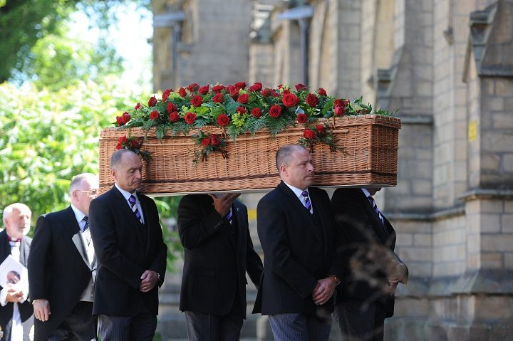 Peter Rankin's coffin is carried into the Minster