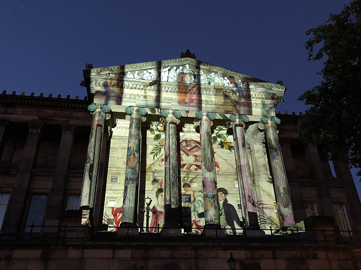 The front of the Harris lit up by the Transfomers for Love Notes To Preston