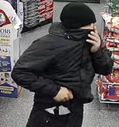 The man is seen with a weapon tucked into his trousers