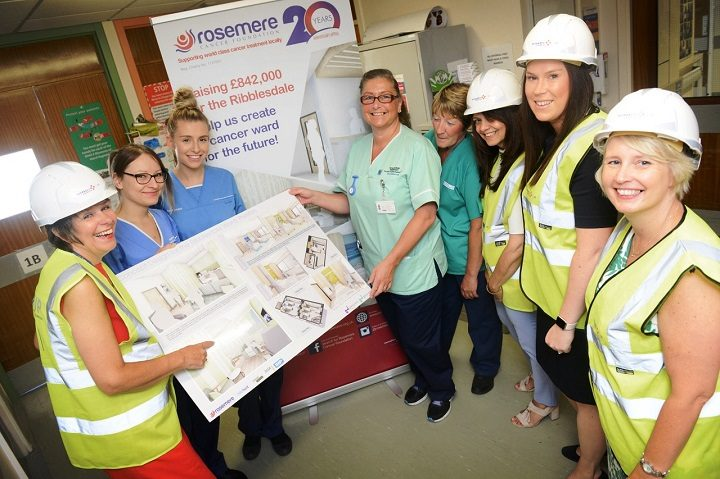 Rosemere and MedEquip4Kids staff with designs for the ward