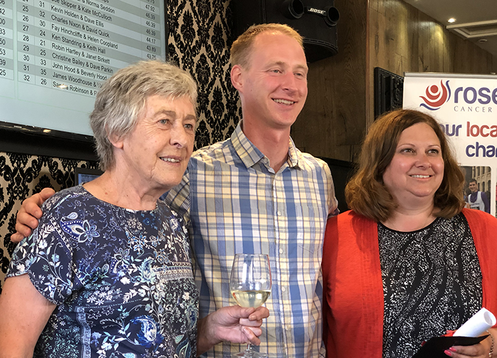 Maureen McConkey (left) and Catherine Draper receiving first prize from Rosemere Cancer Foundation's head of fundraising Dan Hill