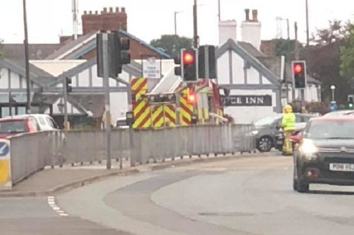 Firefighters are seen at the Liverpool Road junction Pic: Rob Randell