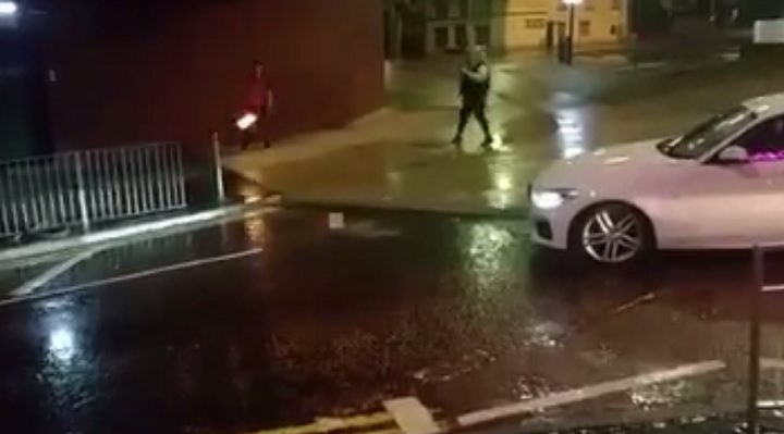 The white BMW is seen illegally parked and watching the firebreather