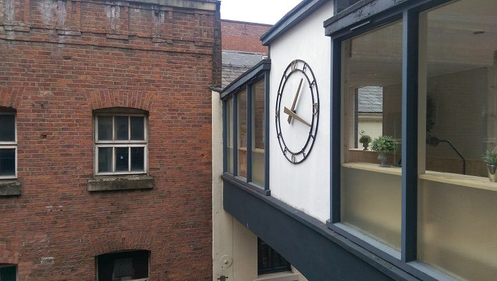 The well-known clock on the bridge over Glovers Court Pic: Blog Preston