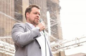 Councillor Drew Gale speaking at Armed Forces Day on the Flag Marketa