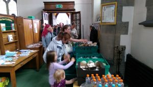 Families move along the tables laid out with the redistributed food Pic: Blog Preston