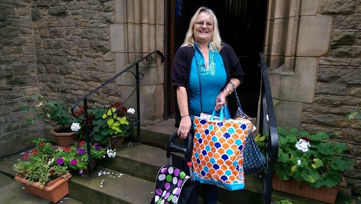 Karen loaded up with supplies as she leaves St Matthews Church Pic: Blog Preston