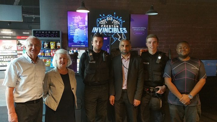 PCSO Stephen Connolly, centre, with members of staff from Game and the police board