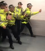 A line of police brandish pepper spray at Stoke City fans