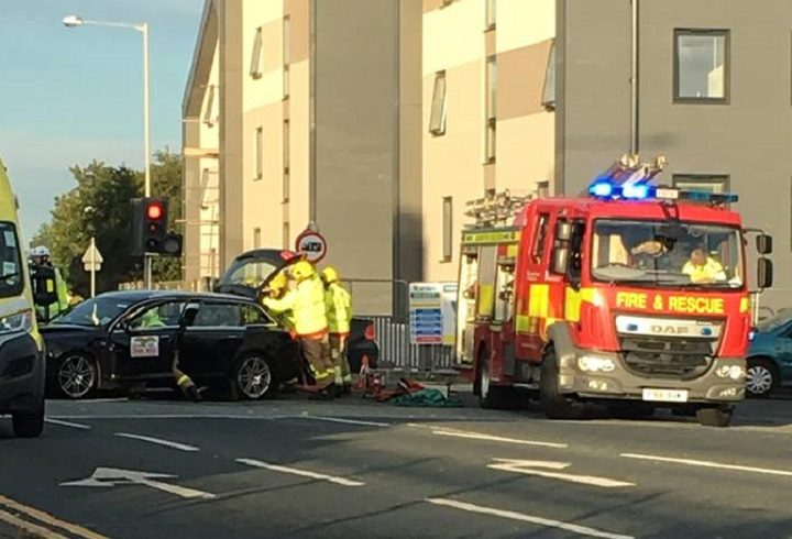 Firefighters using equipment to free the person trapped in the taxi Pic: Kately Hobson