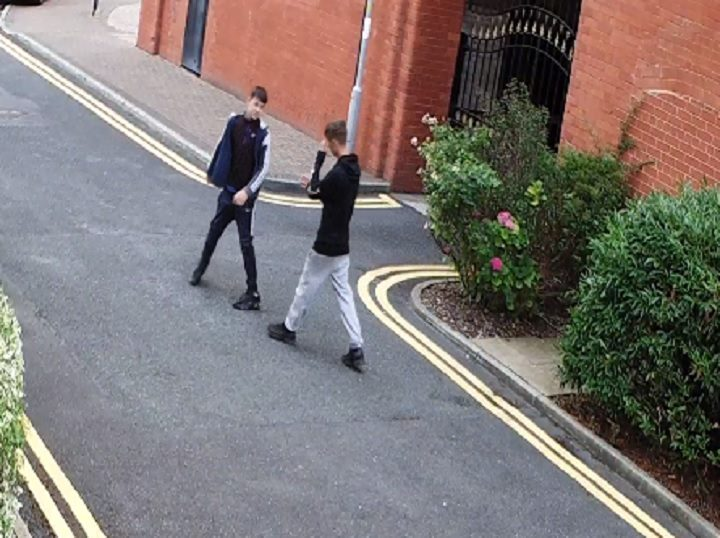 Two of the youths are seen play-fighting on the CCTV