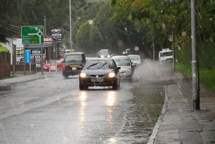 A driver moving to avoid the standing water Pic: Chris Hough