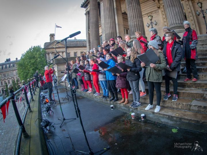 The Lancashire Community Choir in fine voice on the Harris steps Pic: Michael Porter