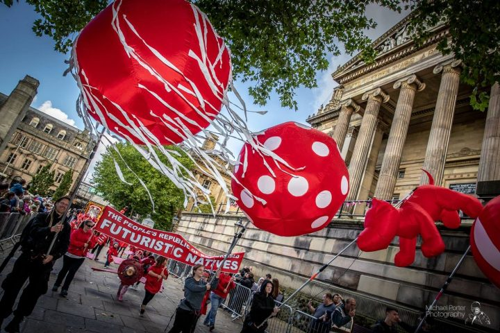 The Red Dream Parade through the city centre Pic: Michael Porter