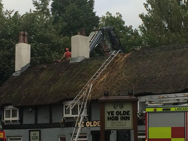 Firefighters can be seen on the roof of the pub Pic: Shane King