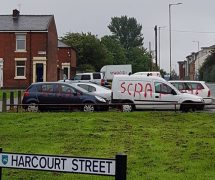 """Several cars were spray-painted with the word """"Scrap"""""""
