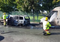 Firefighters put out the flames in both vehicles Pic: Graham Robinson