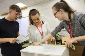 Three students taking on the Flatpack Challenge