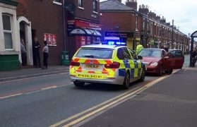 Police at the scene in Plungington Road Pic: Andy Speariett
