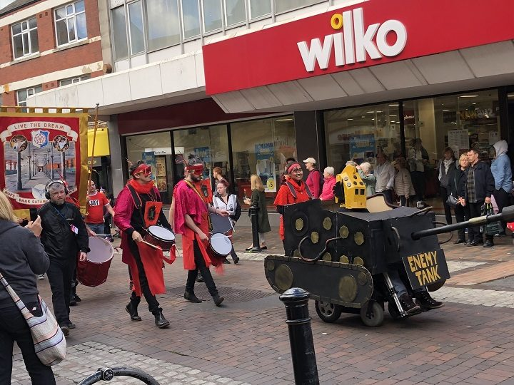 A tank and banner makes its way into Friargate past Wilco's Pic: Tom Costello