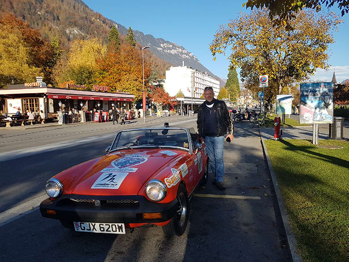 Andrew with his vintage Midget in Switzerland