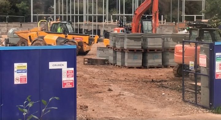 Workers on site in Dovedale Avenue