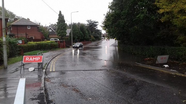 A motorist tries to avoid the floodwater in Black Bull Lane Pic: Blog Preston