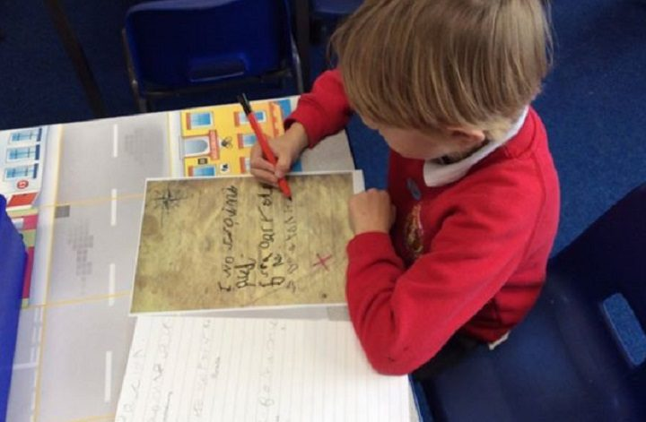One of the pupils penning his story