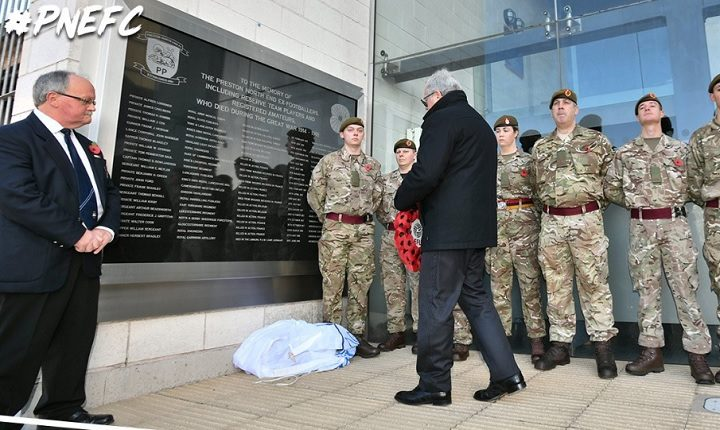 A wreath is laid by the club's historian at Deepdale
