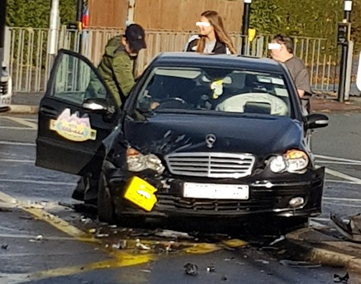 The taxi driver and passengers were unhurt