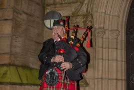 The piper plays Battles O'er Pic: Michael Porter
