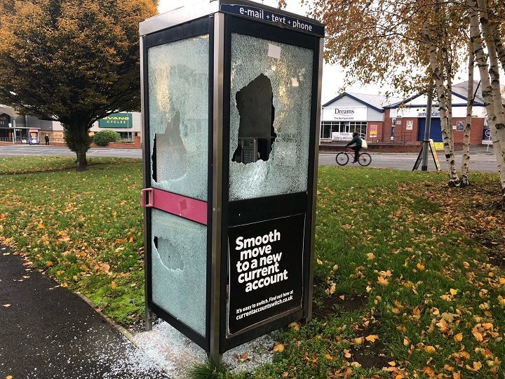 The phone box had its window put through