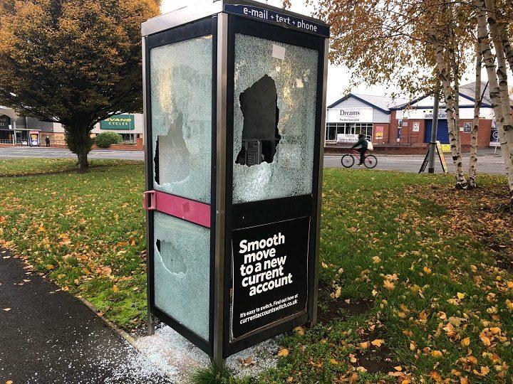 The phone box had its window put through