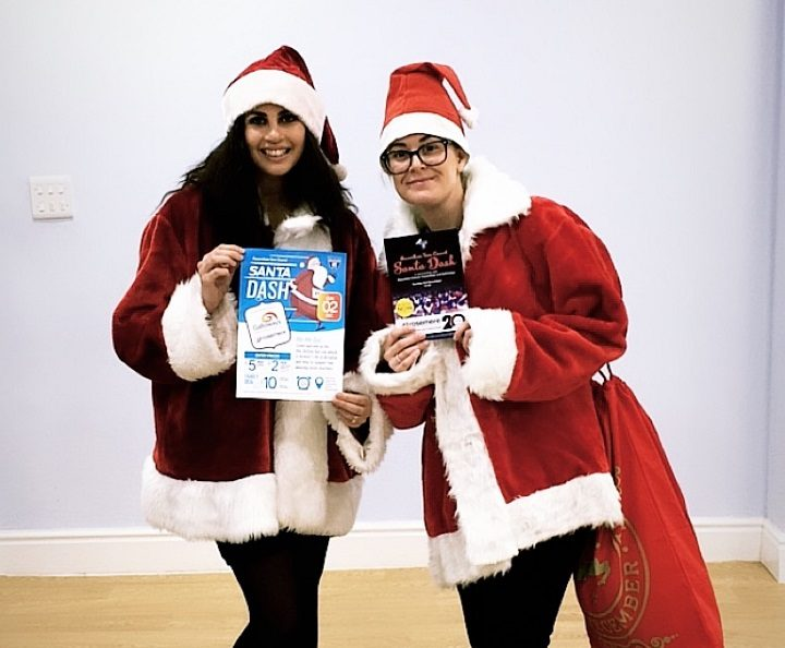 Rebecca and Roya ready to run in their Santa costumes