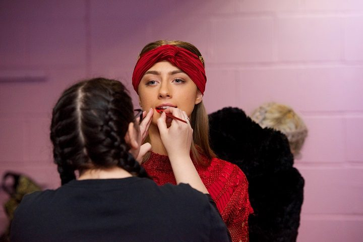 Make up being done before the catwalk shows