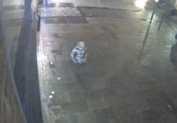 A man in a silver jacket is seen on the CCTV clip