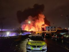 Flames leap from the Preston Motor Village site Pic: Ben Horn
