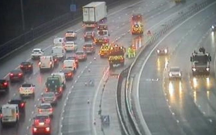 Highways officers working to clear the water in the fourth lane near Junction 30 Pic: Highways England