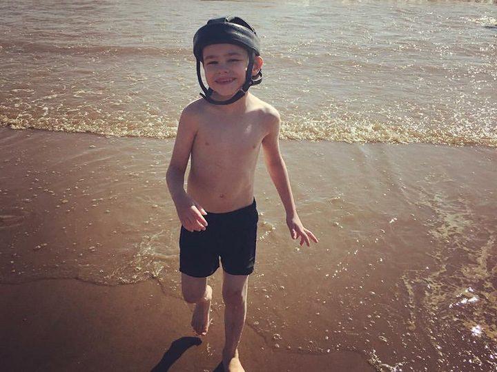 Ben enjoying the beach in happier times