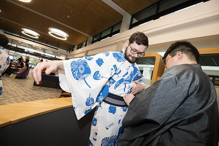 A student trying out a Kimono