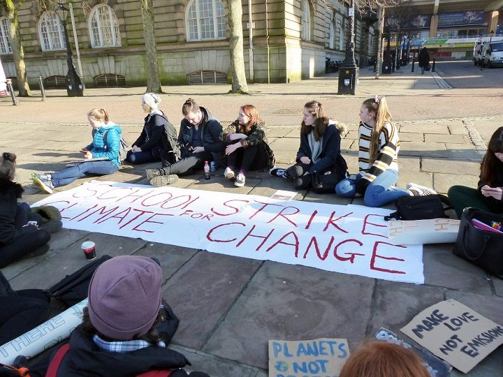 Banner unfurled on the Flag Market by school strike action group in Preston Pic: Jim Beattie