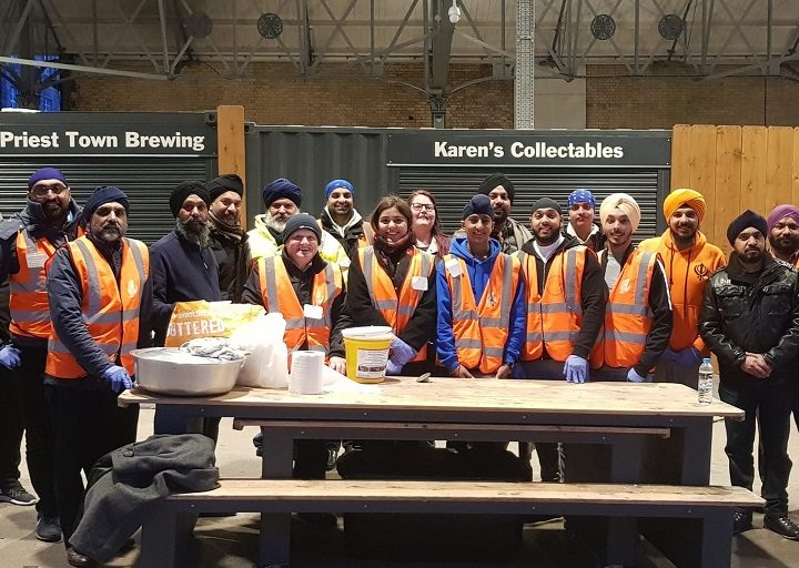 Volunteers who run the food kitchen under the market canopy Pic: Blog Preston