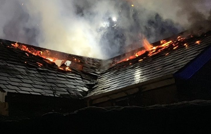Flames coming from the roof of the pub Pic: Tom Heeney