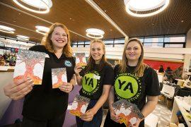 Publisher at UCLan Publishing Hazel Holmes with students Johanna Marton and Jess Ferrier