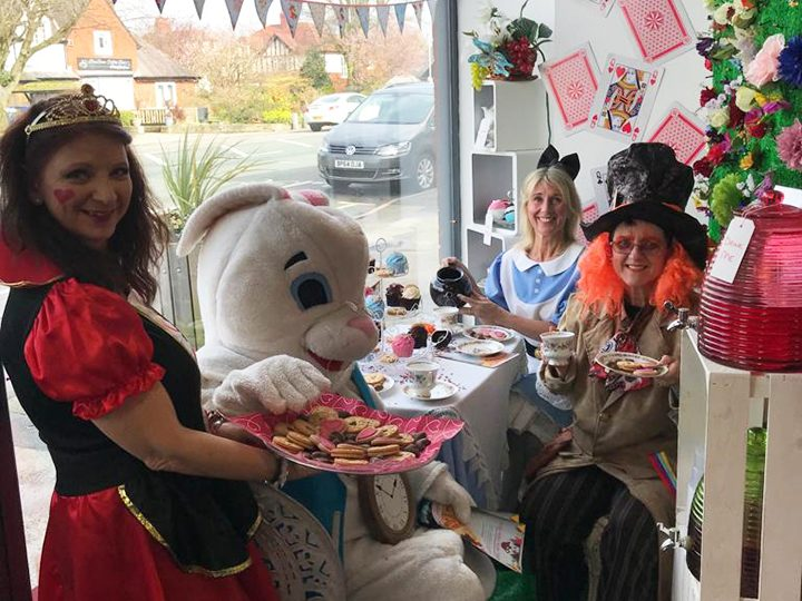 Volunteers and staff dressed up the tea party