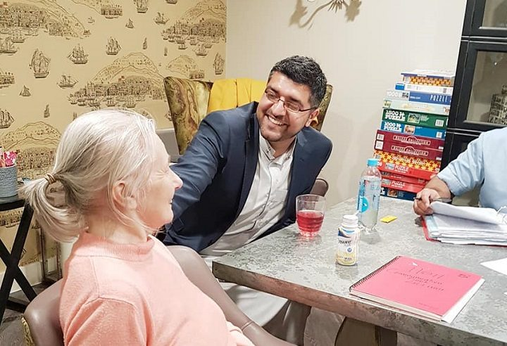 Nadeem meeting a resident at the Tom Finney Care Home Pic: The Light Foundation