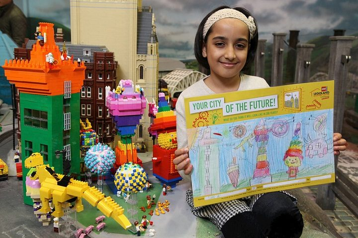 Saira with her drawing and the Lego recreation